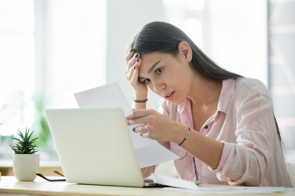 Worried frustrated woman shocked by bad news or rejection reading letter, stressed girl troubled with financial problem, domestic bills or debt, millennial student upset by failed test notification