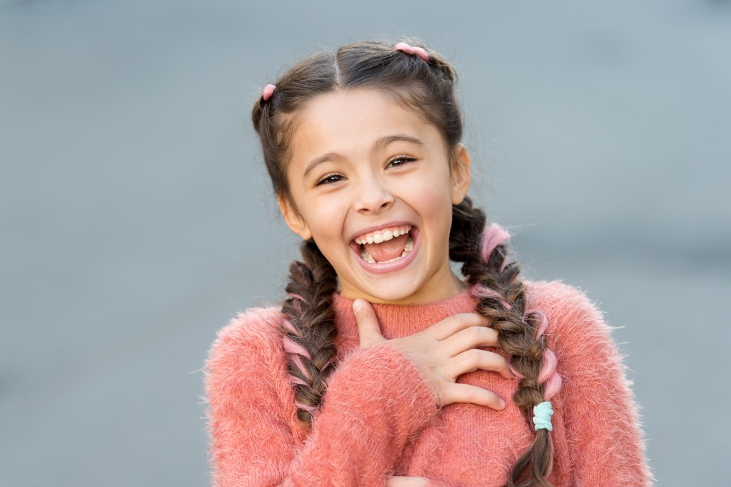 Emotions concept. Almost died laughing. Humor and react funny story. Childhood and happiness concept. Kid with cheerful laughing face. Sincere emotional child laughing. Girl laugh emotional face.