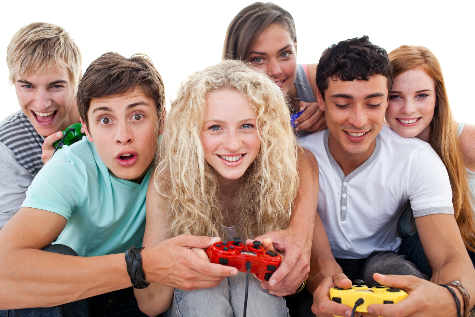 Excited teenagers having fun playing video games in the living-room