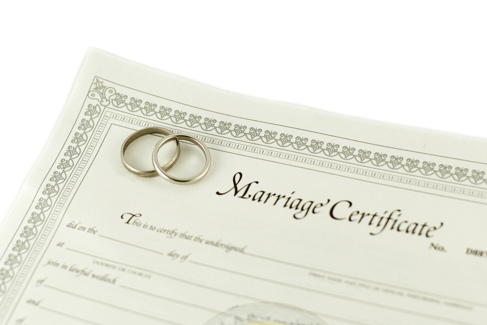 isolated blank certificate with wedding rings